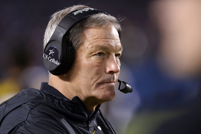 "FILE - In this Dec. 27, 2019, file photo, Iowa coach Kirk Ferentz watches from the sideline during the second half of the team's Holiday Bowl NCAA college football game against Southern California  in San Diego. Iowa football strength and conditioning coach Chris Doyle has been placed on administrative leave after several black former players posted on social media about what they described as systemic racism in the program. Ferentz made the announcement Saturday, June 6, 2020, calling it ""a defining moment"" for Iowa's football program in a video posted on the team's Twitter account. (AP Photo/Orlando Ramirez, File)"