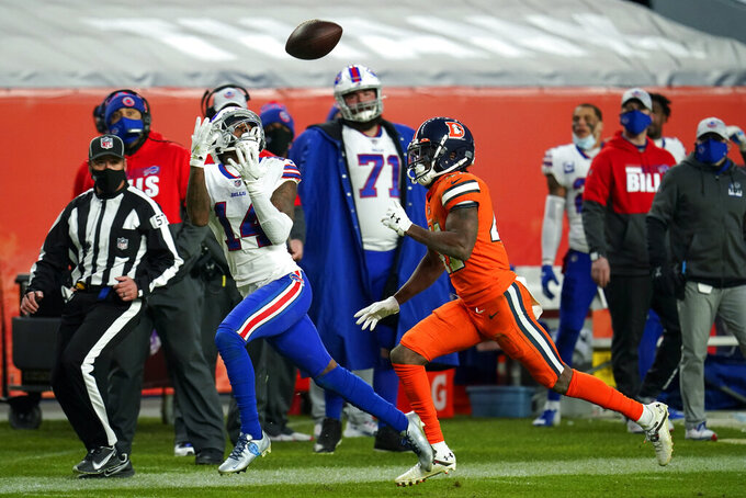 Buffalo Bills wide receiver Stefon Diggs makes a catch as Denver Broncos cornerback De'Vante Bausby defends during the second half of an NFL football game Saturday, Dec. 19, 2020, in Denver. (AP Photo/Jack Dempsey)