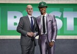 NBA Commissioner Adam Silver, left, poses for photographs with Indiana's Romeo Langford after the Boston Celtics selected him as the 14th pick overall in the NBA basketball draft Thursday, June 20, 2019, in New York. (AP Photo/Julio Cortez)