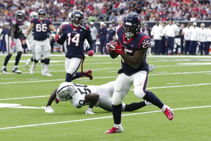Houston Texans running back Duke Johnson (25) catches a pass for a touchdown against the Oakland Raiders during the first half of an NFL football game Sunday, Oct. 27, 2019, in Houston. (AP Photo/Michael Wyke)