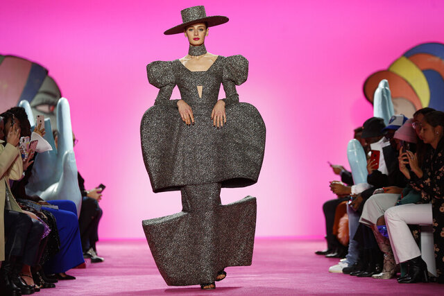 The Christian Siriano collection is modeled during Fashion Week, Thursday, Feb. 6, 2020, in New York. (AP Photo/John Minchillo)