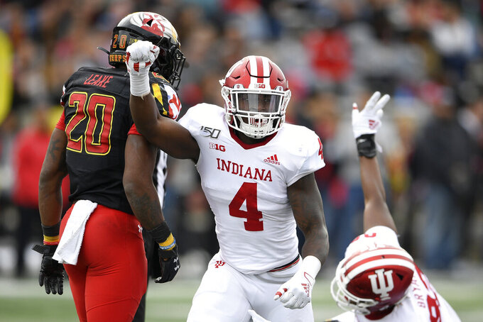 Indiana linebacker Cam Jones (4) reacts as  his team stopped Maryland on a fourth down play during the first half of an NCAA college football game, Saturday, Oct. 19, 2019, in College Park, Md. Maryland running back Javon Leake (20) looks on. (AP Photo/Nick Wass)