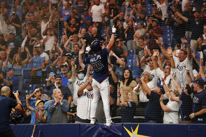 Tampa Bay Rays' Brett Phillips celebrates after hitting a walkoff home run against the Detroit Tigers during a baseball game Friday, Sept. 17, 2021, in St. Petersburg, Fla. (AP Photo/Scott Audette)