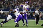 Minnesota Vikings quarterback Kirk Cousins (8) throws a pass under pressure in the second half of the team's NFL football game against the Dallas Cowboys in Arlington, Texas, Sunday, Nov. 10, 2019. (AP Photo/Michael Ainsworth)