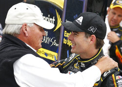 FILE - Jeff Gordon, right, celebrates his victory with team owner Rick Hendrick after the NASCAR Sprint Cup Series Pure Michigan 400 auto race at Michigan International Speedway in Brooklyn, Mich., in this Sunday, Aug. 17, 2014, file photo. Jeff Gordon will leave the Fox Sports booth for a daily role at Hendrick Motorsports as vice chairman ranked second only to majority owner Rick Hendrick. The new job positions the four-time champion and Hall of Famer to eventually succeed Hendrick at the top of NASCAR's winningest organization.  (AP Photo/Bob Brodbeck, File)