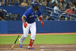 Toronto Blue Jays' Vladimir Guerrero Jr. watches his solo home run against the Minnesota Twins during the third inning of a baseball game Friday, Sept. 17, 2021, in Toronto. (Jon Blacker/The Canadian Press via AP)