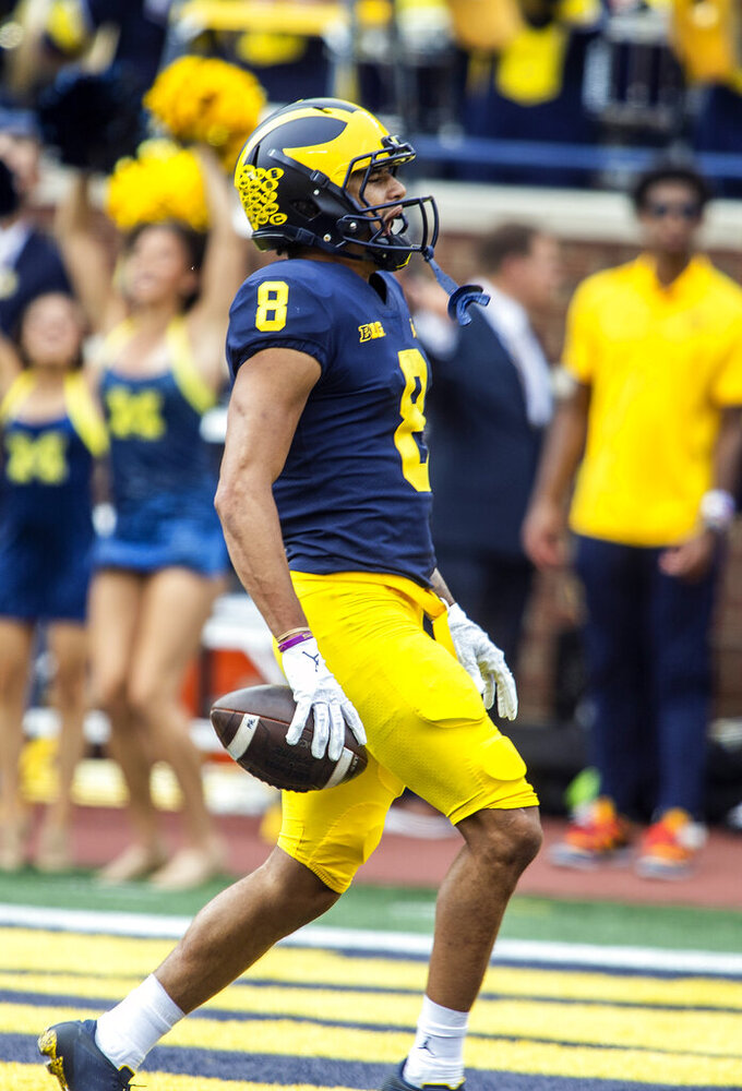 Michigan wide receiver Ronnie Bell celebrates his 76-yard reception for touchdown in the second quarter of an NCAA college football game against Western Michigan in Ann Arbor, Mich., Saturday, Sept. 4, 2021. (AP Photo/Tony Ding)