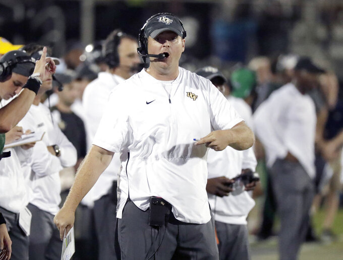 FILE - In this Sept. 21, 2018, file photo, Central Florida coach Josh Heupel directs his team against Florida Atlantic during the second half of an NCAA college football game, in Orlando, Fla. Heupel wants his Knights ready for their first road game in a month, against Memphis. (AP Photo/John Raoux, File)