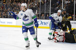 Vancouver Canucks right wing Brock Boeser, left, celebrates after scoring against the Vegas Golden Knights during the third period of an NHL hockey game Sunday, Dec. 15, 2019, in Las Vegas. (AP Photo/John Locher)
