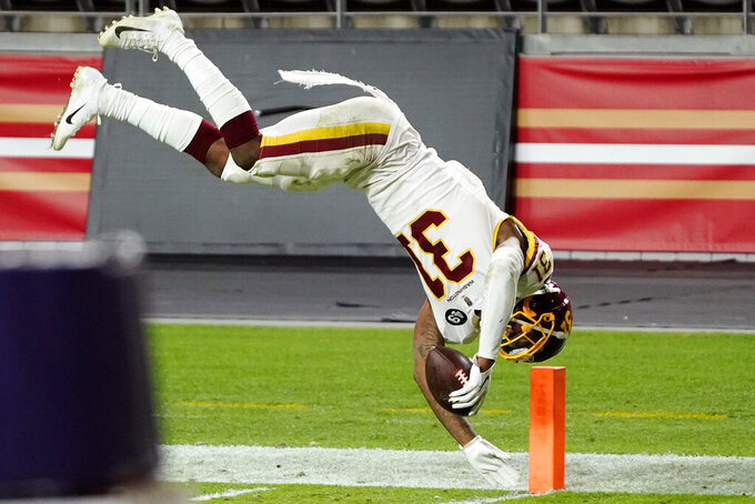 Washington Football Team strong safety Kamren Curl (31) dives into the end zone for a touchdown after an interception against the San Francisco 49ers during the second half of an NFL football game, Sunday, Dec. 13, 2020, in Glendale, Ariz. (AP Photo/Rick Scuteri)