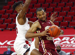 Boston College's Steffon Mitchell (41) looks for room as North Carolina State's Manny Bates (15) defends during the first half of an NCAA college basketball game in Raleigh, N.C., Wednesday, Dec. 30, 2020. (Ethan Hyman/The News & Observer via AP, Pool)