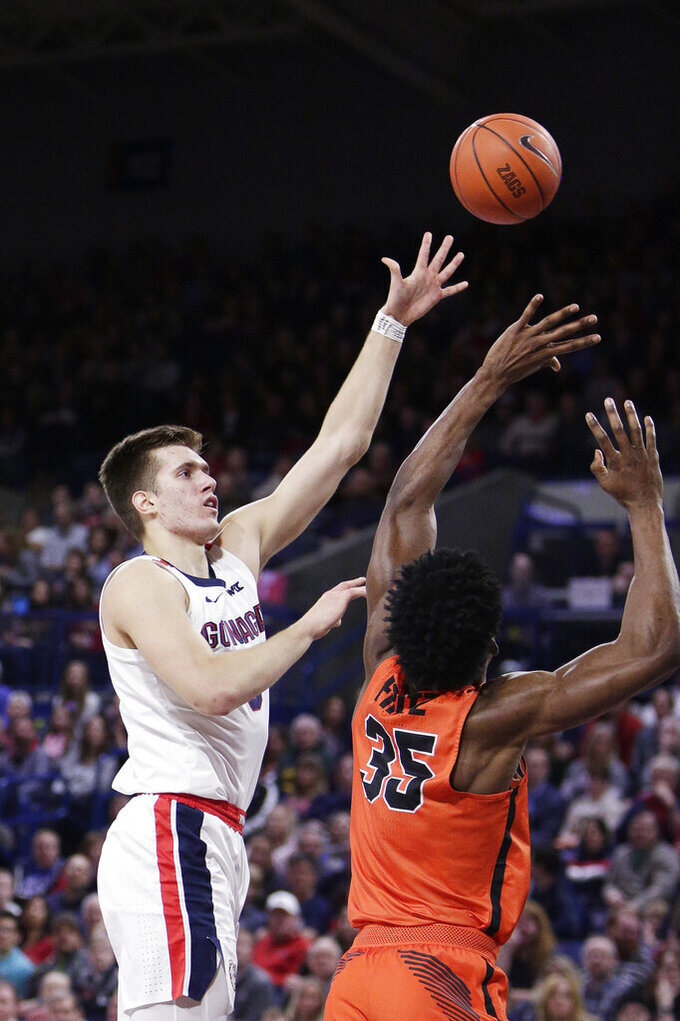 Gonzaga forward Filip Petrusev, left, shoots over Pacific forward Shaquillo Fritz during the first half of an NCAA college basketball game in Spokane, Wash., Saturday, Jan. 25, 2020. (AP Photo/Young Kwak)