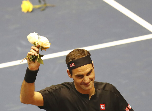 Roger Federer thanks the crowd after winning an exhibition game against Alexander Zverev at Rumiñahui Coliseum in Quito, Ecuador, Sunday, Nov. 24, 2019. (AP Photo/Dolores Ochoa)