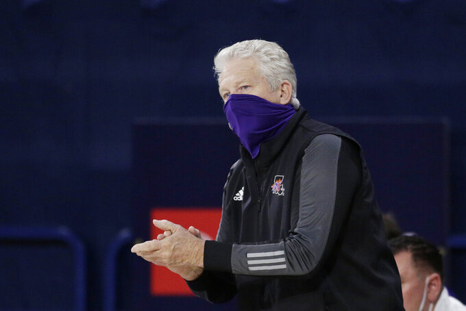 Northwestern State head coach Mike McConathy reacts during the first half of an NCAA college basketball game against Gonzaga in Spokane, Wash., Monday, Dec. 21, 2020. (AP Photo/Young Kwak)