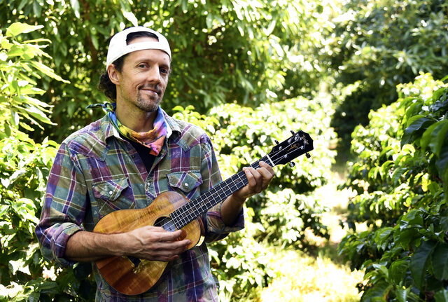 "In this June 16, 2020 photo, singer-songwriter Jason Mraz poses for a portrait at his home in Oceanside, Calif., to promote his new reggae album ""Look for the Good."" The two-time Grammy-winner is donating all earnings from sales and streams of his album, including his $250,000 advance, to groups advancing equality and justice. (AP Photo/Chris Pizzello)"