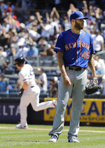 New York Mets starting pitcher Zack Wheeler, right, reacts as New York Yankees' Luke Voit runs the bases after hitting a three-run home run during the fourth inning in the first baseball game of a doubleheader, Tuesday, June 11, 2019, in New York. (AP Photo/Frank Franklin II)