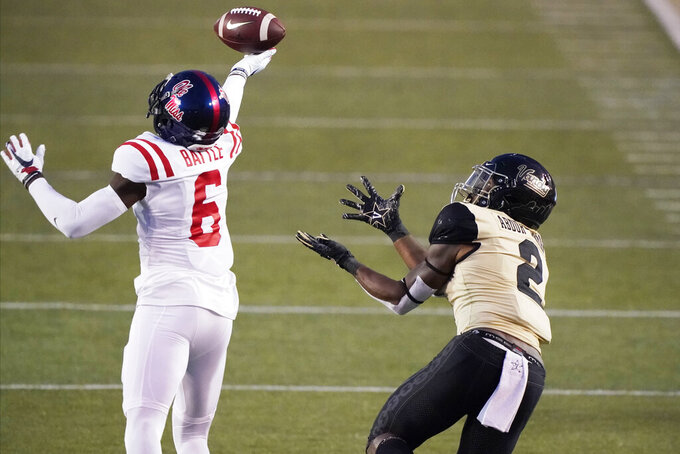 Mississippi defensive back Miles Battle (6) breaks up a pass intended for Vanderbilt wide receiver Amir Abdur-Rahman (2) in the second half of an NCAA college football game Saturday, Oct. 31, 2020, in Nashville, Tenn. Mississippi won 54-21. (AP Photo/Mark Humphrey)