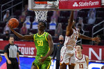 Oregon forward Eric Williams Jr. (50) shoots against Southern California forward Evan Mobley (4) during the first half of an NCAA college basketball game Monday, Feb. 22, 2021, in Los Angeles. (AP Photo/Ashley Landis)