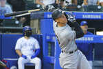 New York Yankees Aaron Judge hits a foul ball during the fifth inning of a baseball game against the Toronto Blue Jays, Tuesday, June 15, 2021, in Buffalo, N.Y. (AP Photo/Jeffrey T. Barnes)