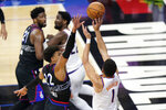 Phoenix Suns' Devin Booker, right, goes up for a shot against Philadelphia 76ers' Matisse Thybulle during the second half of an NBA basketball game, Wednesday, April 21, 2021, in Philadelphia. (AP Photo/Matt Slocum)