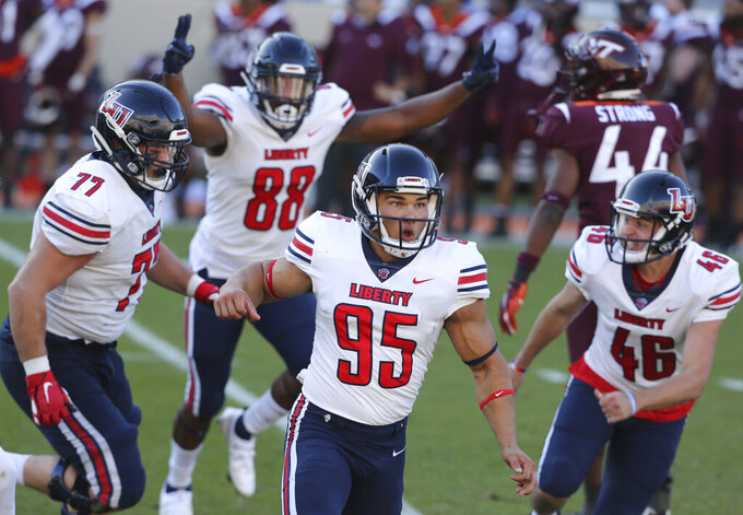 Liberty's Alex Barbir (95) celebrates kicking the game-winning field goal in the last second of the fourth quarter of an NCAA college football game against Virginia Tech, Saturday, Nov. 7 2020, in Blacksburg, Va. Liberty won 38-35. (Matt Gentry/The Roanoke Times via AP, Pool)