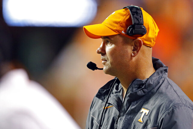 Tennessee head coach Jeremy Pruitt watches the first half of an NCAA college football game against Vanderbilt, Saturday, Nov. 30, 2019, in Knoxville, Tenn. (AP Photo/Wade Payne)