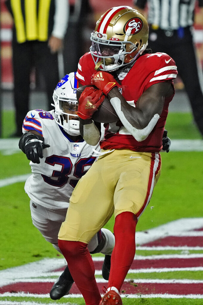 San Francisco 49ers wide receiver Brandon Aiyuk (11) pulls in a touchdown catch as Buffalo Bills cornerback Levi Wallace (39) defends during the first half of an NFL football game, Monday, Dec. 7, 2020, in Glendale, Ariz. (AP Photo/Rick Scuteri)