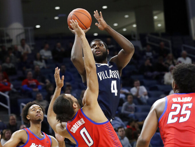 Villanova forward/guard Eric Paschall (4) shoots over DePaul guard Lyric Shreiner (0) during the first half of an NCAA college basketball game Wednesday, Jan. 30, 2019, in Chicago. (AP Photo/Nam Y. Huh)