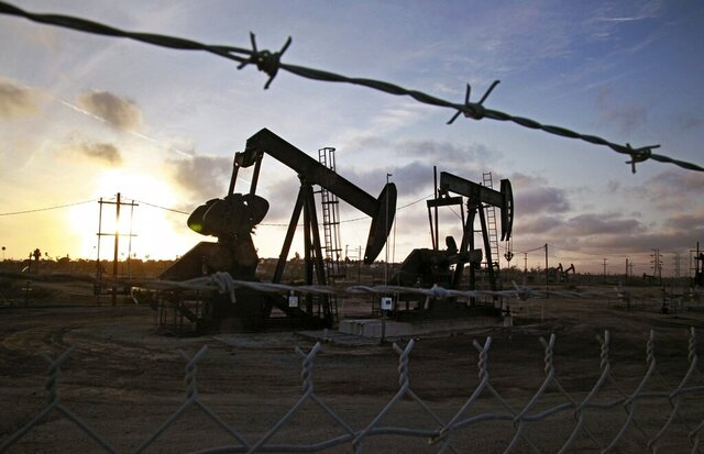 FILE - In this Thursday March 6, 2014, file photo, the sun sets beyond pumpjacks operating at the Inglewood oil fields in the Baldwin Hills area of Los Angeles. California issued new fracking permits Friday, April 3, 2020. It's the first new permits issued since July of last year, when Gov. Gavin Newsom fired the state's top oil and gas regulator after a report showed fracking permits had increased 35 percent since Newsom took office. (AP Photo/Richard Vogel, File)