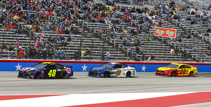 Driver Jimmie Johnson (48) leads drivers Chase Elliot (9) and Joey Logano (22) during a NASCAR Cup auto race at Texas Motor Speedway, Sunday, March 31, 2019, in Fort Worth, Texas. (AP Photo/Randy Holt)