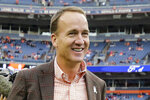 FILE - In this Nov. 4, 2018 file photo, former Denver Broncos quarterback Peyton manning talks prior to an NFL football game between the Denver Broncos and the Houston Texans in Denver.  The roster of men entering the Pro Football Hall of Fame this weekend of Saturday, Aug. 7, 2021, features everything from the prolific passer, to the dominant defender,  and not to mention coaches.   (AP Photo/Jack Dempsey, File)