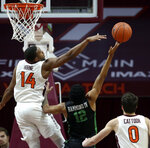 Virginia Tech's P..J. Horne (14) attempts to block a shot by South Carolina-Upstate's Everette Hammond (12) during the first half of an NCAA college basketball game Wednesday, Nov. 13, 2019, in Blacksburg, Va. (Matt Gentry/The Roanoke Times via AP)