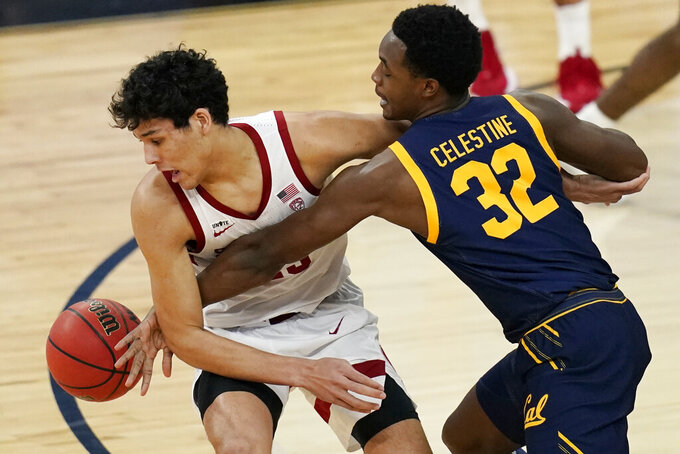 California's Jalen Celestine (32) fouls Stanford's Brandon Angel (23) during the first half of an NCAA college basketball game in the first round of the Pac-12 men's tournament Wednesday, March 10, 2021, in Las Vegas. (AP Photo/John Locher)