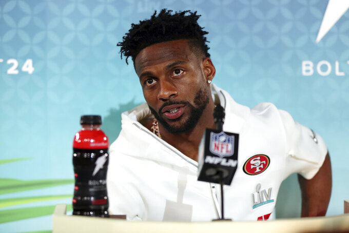 FILE - Then-San Francisco 49ers wide receiver Emmanuel Sanders speaks to the media during Opening Night for the NFL Super Bowl 54 football game in Miami, in this Monday, Jan. 27, 2020, file photo. New Orleans Saints first-year receiver Emmanuel Sanders is trying to reach his fourth Super Bowl with a fourth different team. (AP Photo/Steve Luciano, File)