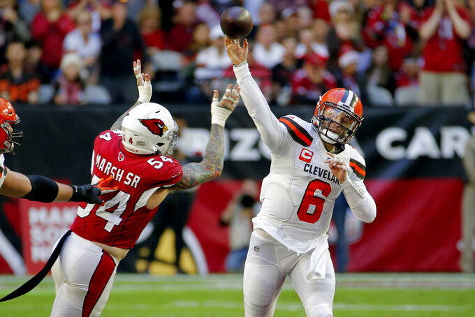 Cleveland Browns quarterback Baker Mayfield (6) throws under pressure from Arizona Cardinals linebacker Cassius Marsh (54) during the first half of an NFL football game, Sunday, Dec. 15, 2019, in Glendale, Ariz. (AP Photo/Rick Scuteri)