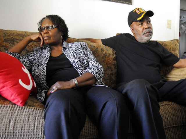 FILE - In this Nov. 16, 2016 file photo, Sarah Collins Rudolph and her husband, George Rudolph, discuss their worries about the upcoming Donald Trump presidency in their home in Birmingham, Ala..  Rudolph, the survivor of the 1963 church bombing that killed four little girls, is seeking an apology and restitution from the state of Alabama.  (AP Photo/Jay Reeves)