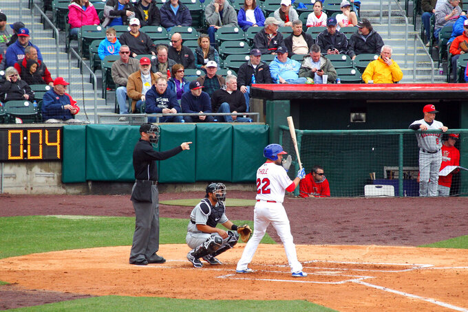 FILE - In this April 9, 2015, file photo, home plate umpire Seth Buckminster signals for the pitch as Buffalo Bisons batter Josh Thole (22) steps into the box during a Triple-A baseball game between the Bisons and Rochester Red Wings in Buffalo, N.Y. The displaced Toronto Blue Jays will play in Buffalo, New York, this year amid the pandemic. An official familiar with the matter told The Associated Press on Friday that the Blue Jays will play at Sahlen Field. The official spoke on condition of anonymity as they were not authorized to speak publicly ahead of an announcement. (AP Photo/Bill Wippert, File