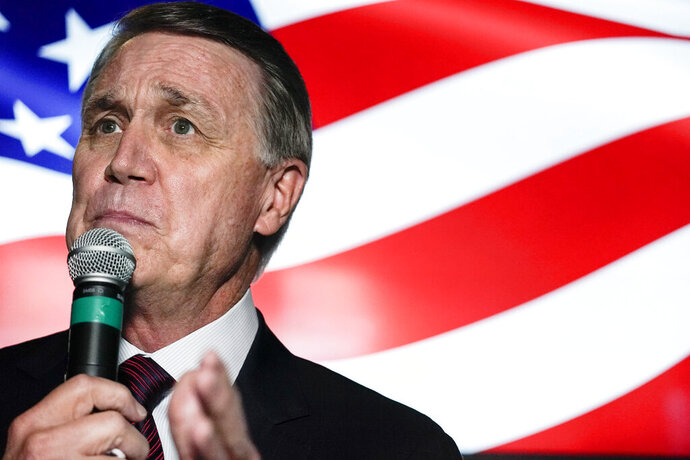 FILE - In this Friday, Nov. 13, 2020 file photo, candidate for U.S. Senate Sen. David Perdue speaks during a campaign rally, in Cumming, Ga. Perdue is hoping years spent as one of Donald Trump's biggest defenders pays off in Georgia, a state the president lost in last month's election. Perdue and Georgia's other senator, Republican Kelly Loeffler, are both campaigning for Jan. 5 runoff elections that will decide control of the Senate. (AP Photo/Brynn Anderson, File)