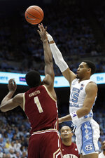 North Carolina forward Garrison Brooks (15) shoots while Boston College forward Jairus Hamilton (1) defends during the first half of an NCAA college basketball game in Chapel Hill, N.C., Saturday, Feb. 1, 2020. (AP Photo/Gerry Broome)