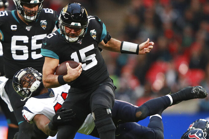 Houston Texans inside linebacker Zach Cunningham (41) tackles Jacksonville Jaguars quarterback Gardner Minshew (15) during the second half of an NFL football game at Wembley Stadium, Sunday, Nov. 3, 2019, in London. (AP Photo/Ian Walton)