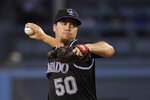 Colorado Rockies starting pitcher Chi Chi Gonzalez throws during the first inning of the team's baseball game against the Los Angeles Dodgers on Tuesday, Sept. 3, 2019, in Los Angeles. (AP Photo/Mark J. Terrill)