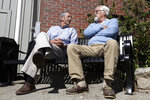 Republican presidential candidate former South Carolina Gov. Mark Sanford, left, chats withKen Demick, of Manchester, N.H., as he campaigns, Thursday, Sept. 19, 2019, in Manchester. (AP Photo/Elise Amendola)