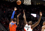 Oklahoma City Thunder guard Luguentz Dort, left, shoots the ball over Portland Trail Blazers forward Nassir Little, right, during the first half of an NBA basketball game in Portland, Ore., Sunday, Dec. 8, 2019. (AP Photo/Steve Dykes)