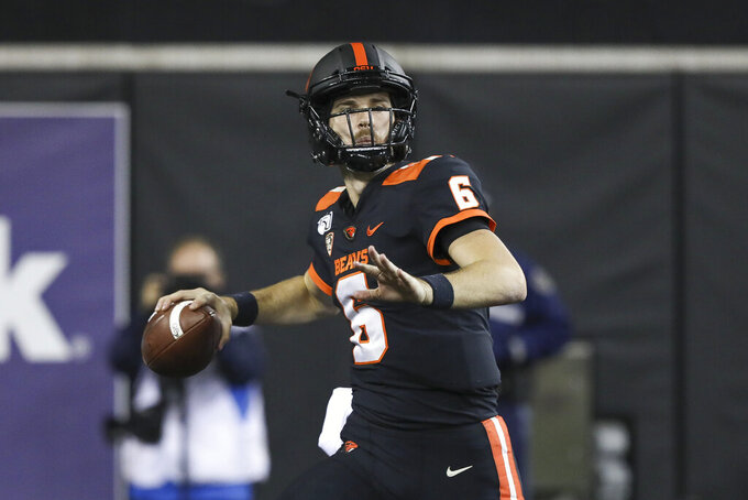 Oregon State quarterback Jake Luton prepares to throw a pass during the second half of the team's NCAA college football game against Utah in Corvallis, Ore., Saturday, Oct. 12, 2019. Utah won 52-7. (AP Photo/Amanda Loman)