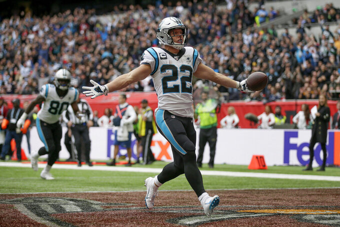 FILE - In this Oct. 13, 2019, file photo, Carolina Panthers running back Christian McCaffrey (22) reacts after scoring a touchdown against the Tampa Bay Buccaneers during the second quarter of an NFL football game at Tottenham Hotspur Stadium in London. Luke McCaffrey, the younger brother of the Panthers' star running back and son of former NFL receiver Ed McCaffrey, made an unexpected entrance for Nebraska against Indiana last week and turned in a strong performance. (AP Photo/Tim Ireland, File)