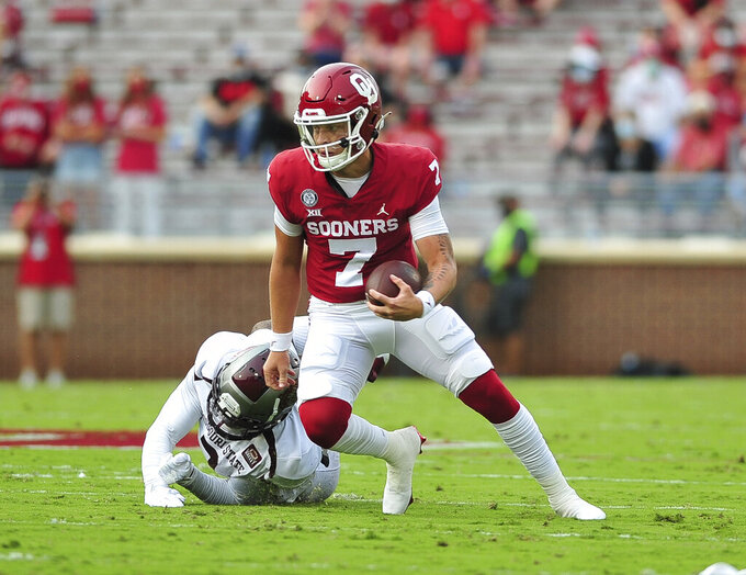 Oklahoma quarterback Spencer Rattler runs with the ball during an NCAA college football game against Missouri State, Saturday, Sept. 12, 2020, in Norman, Okla. (Kyle Phillips/The Norman Transcript via AP)