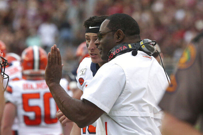 Syracuse's head coach Dino Babers, right, talks with his quarterback Tommy DeVito during the first quarter of an NCAA college football game with Florida State, Saturday, Oct. 26, 2019, in Tallahassee Fla. (AP Photo/Steve Cannon)