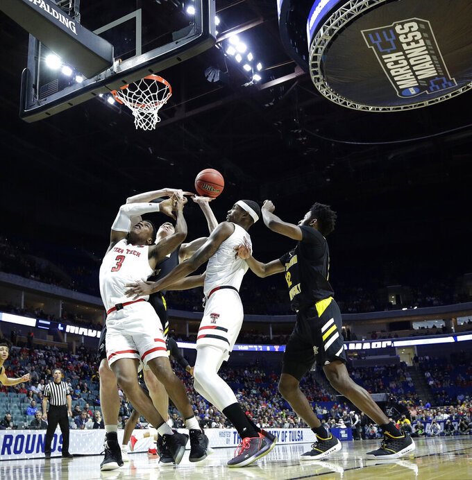 Texas Tech's Deshawn Corprew (3) and Northern Kentucky's Chris Vogt, second from left, battle for a rebound during the first half of a first round men's college basketball game in the NCAA Tournament Friday, March 22, 2019, in Tulsa, Okla. (AP Photo/Charlie Riedel)
