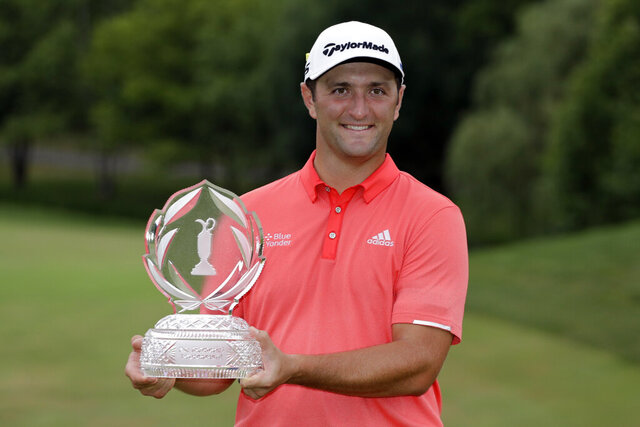 FILE - In this a, Jon Rahm, of Spain, poses with the trophy after winning the Memorial golf tournament in Dublin, Ohio. The No. 1 player in the world is Rahm. The best player in golf? With this kind of depth, that depends on the week. Rahm begins his new reign hopeful it lasts more than a week.  (AP Photo/Darron Cummings, File)