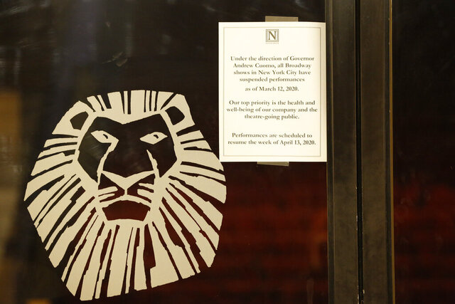 A sign announcing the suspension of all Broadway shows is posted on a door at the Minskoff Theatre, where